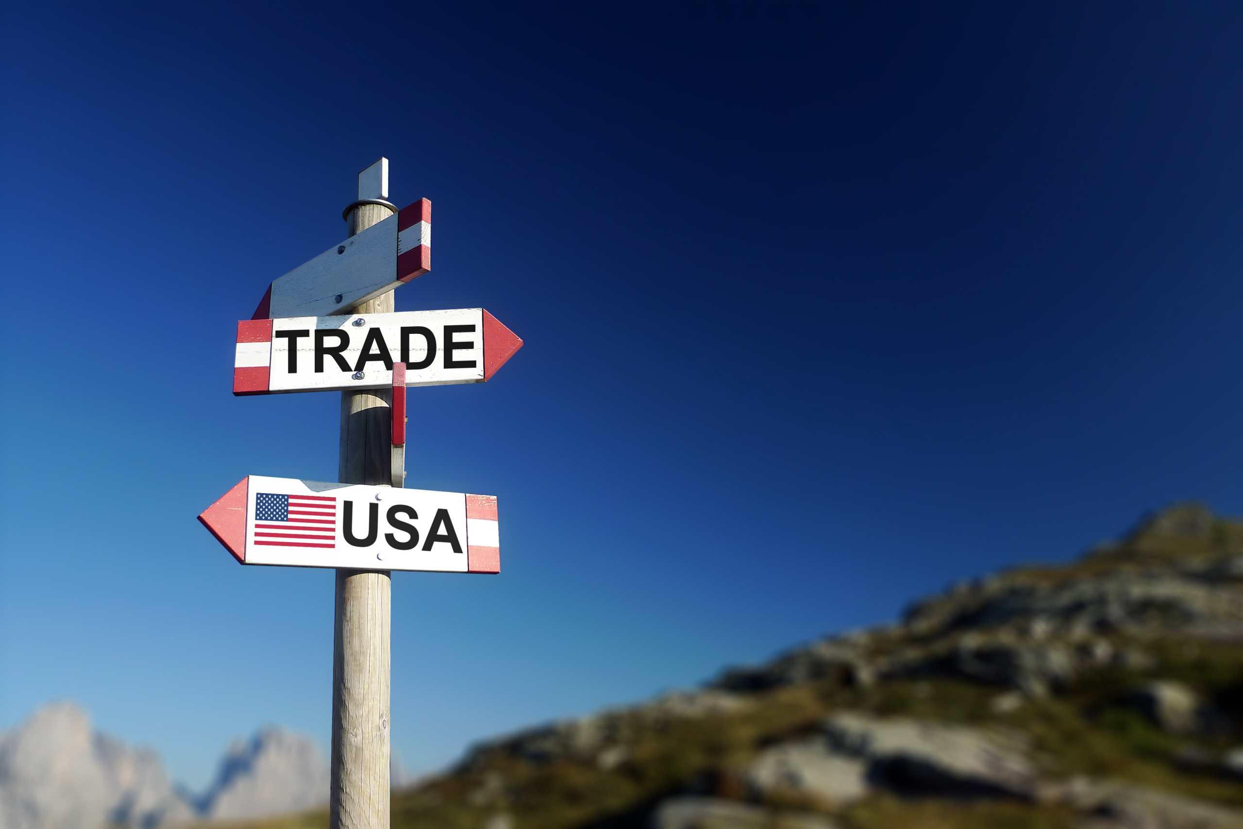 Wegweiser zeigt Handel und USA in unterschiedlichen Richtungen an